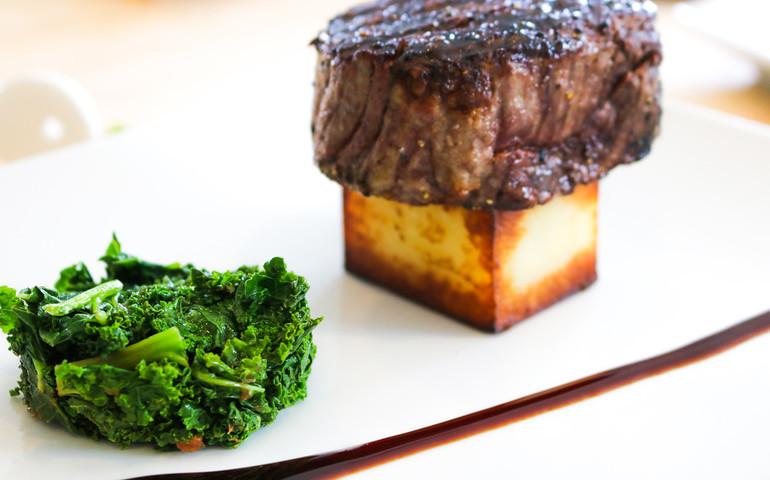Dry Aged New York Strip Steak, Potato Block, Bacon Greens, Truffle Butter
