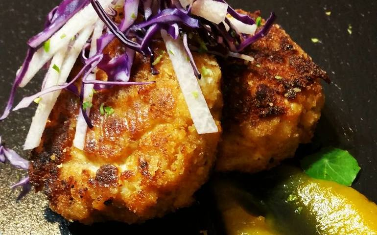 Seared Crabcakes paired with a Jicama Slaw and a Sweet Butternut Squash Puree.