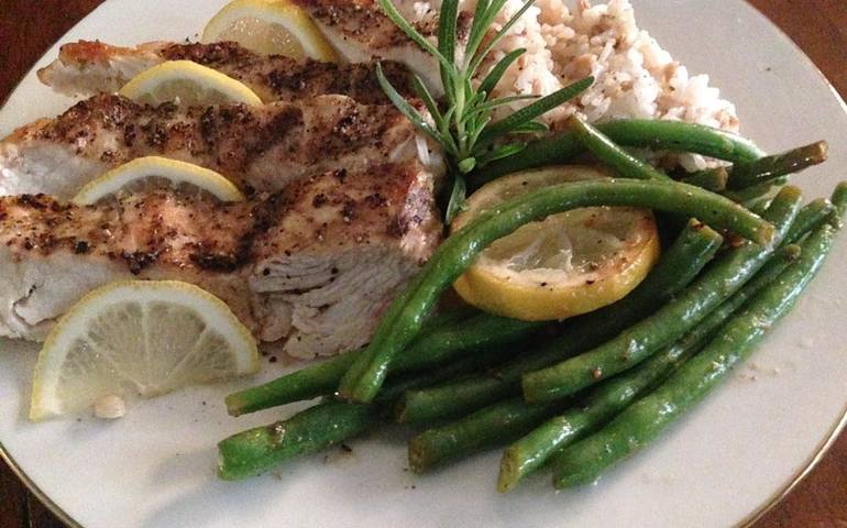 With sautéed green beans tossed w/ bacon & lemon wheels along side steamed jasmine rice-lemon farro blend
