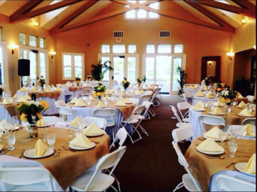 Need an indoor space for your special event or wedding?  Harveston Lake venue presents gorgeously with these round tables covered in burlap overlays and white linens set for the guests to partake in the celebration