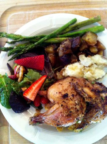Lemon scented Cornish Game Hen on cornbread stuffing accompanied with our roasted red potatoes, grilled asparagus with a balsamic glaze, plus garlic mashed potatoes and a garden green salad garnished with maple glazed pecans and fresh, local strawberries.